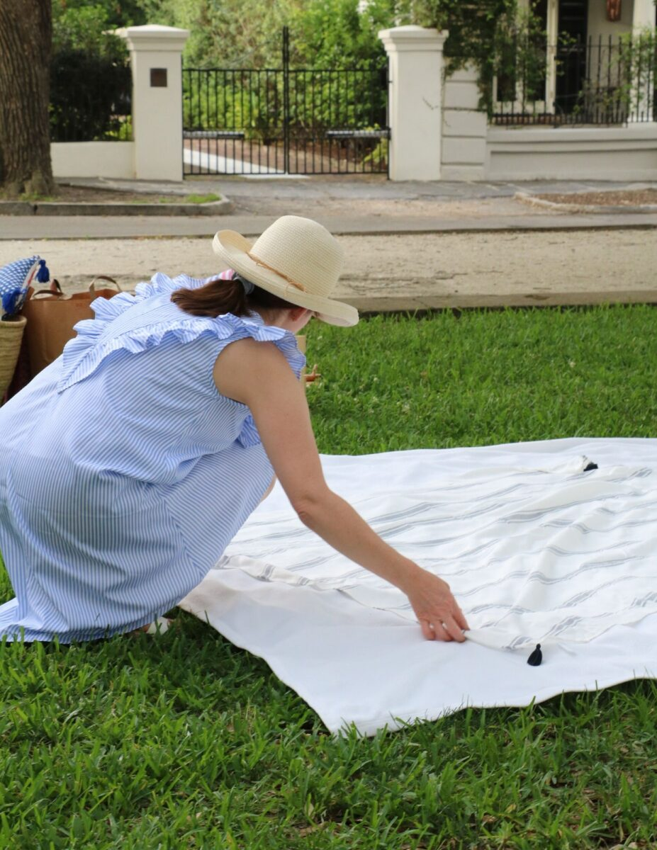 Patriotic picnic ideas using layered blankets on the ground.