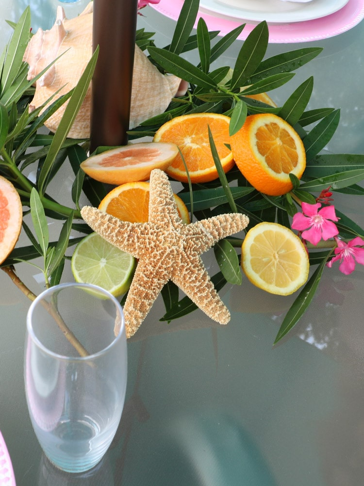 An Hawaiian themed center piece. with leafs, cut citric, and starfish.