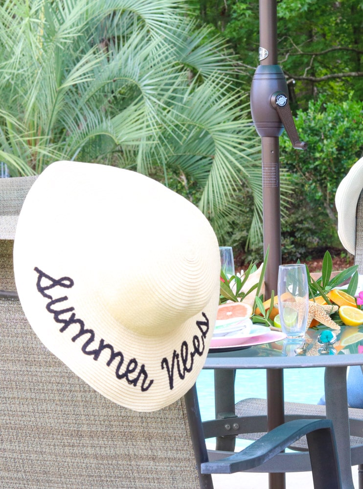 A Summer party idea, With bright citrus in the background with a floppy hat as an extra piece of decor that adds a lot.