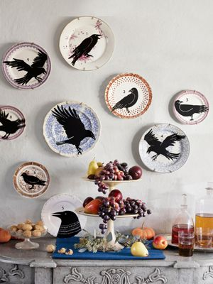 Easy to make Halloween decorations. Wall of plates with different black silhouettes of birds.  Some birds are sitting while others look like they are flying.