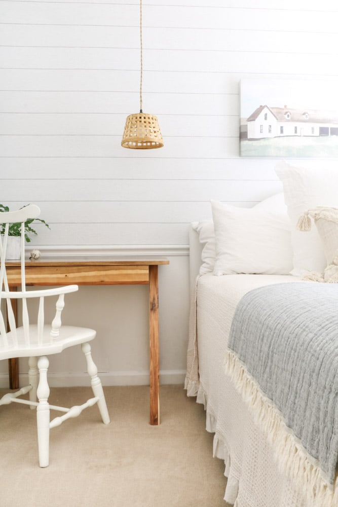 How to make an upholstered headboard from an old metal bed and bleached drop cloth for a guest bedroom.