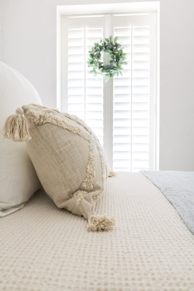 Decorating with wreaths indoors with a small wreath on shutters