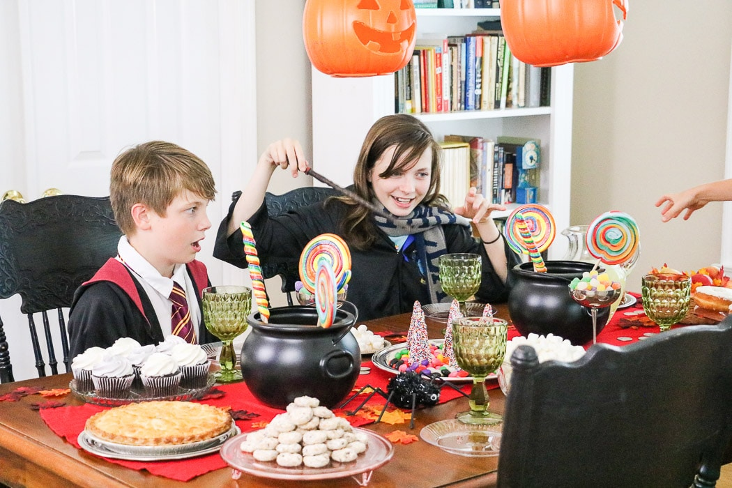 Super easy and fun Hogwarts Halloween inspired Harry Potter table decorations with lots of candy, floating jack o lanterns and more.