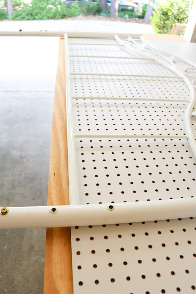 Making a upholstered headboard with a pegboard and old metal bed frame.