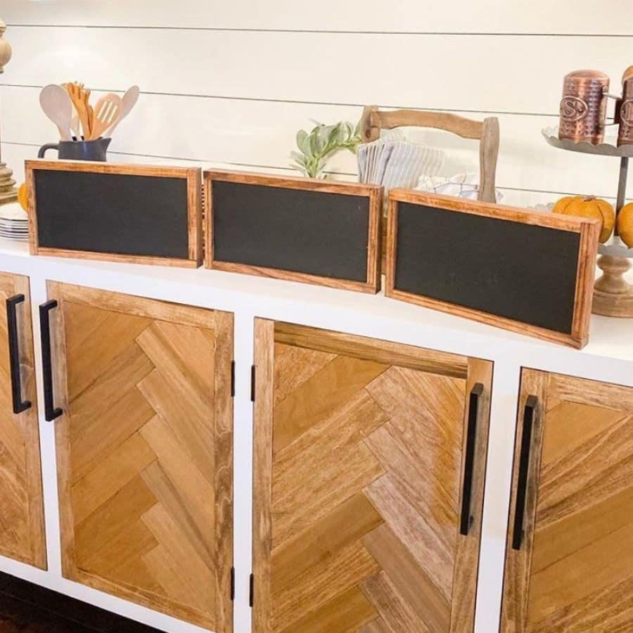 3 DIY chalk boards were created here and placed on a buffet. Each was created with the came slices of wood to make 3 identical chalkboards with matching frames.
