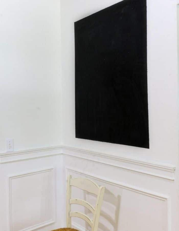 Here is the homemade chalkboard painted on the wall after the painters tape was removed.