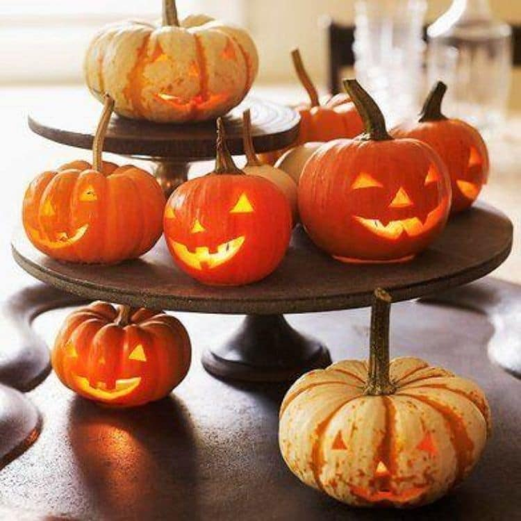 Better Homes and Garden fun small jack o lanterns sitting on layered cakes stands or tiered tray.