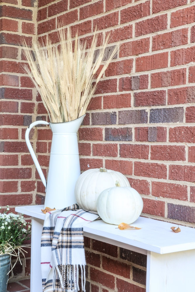 Fall front porch decorations using a homemade white bench