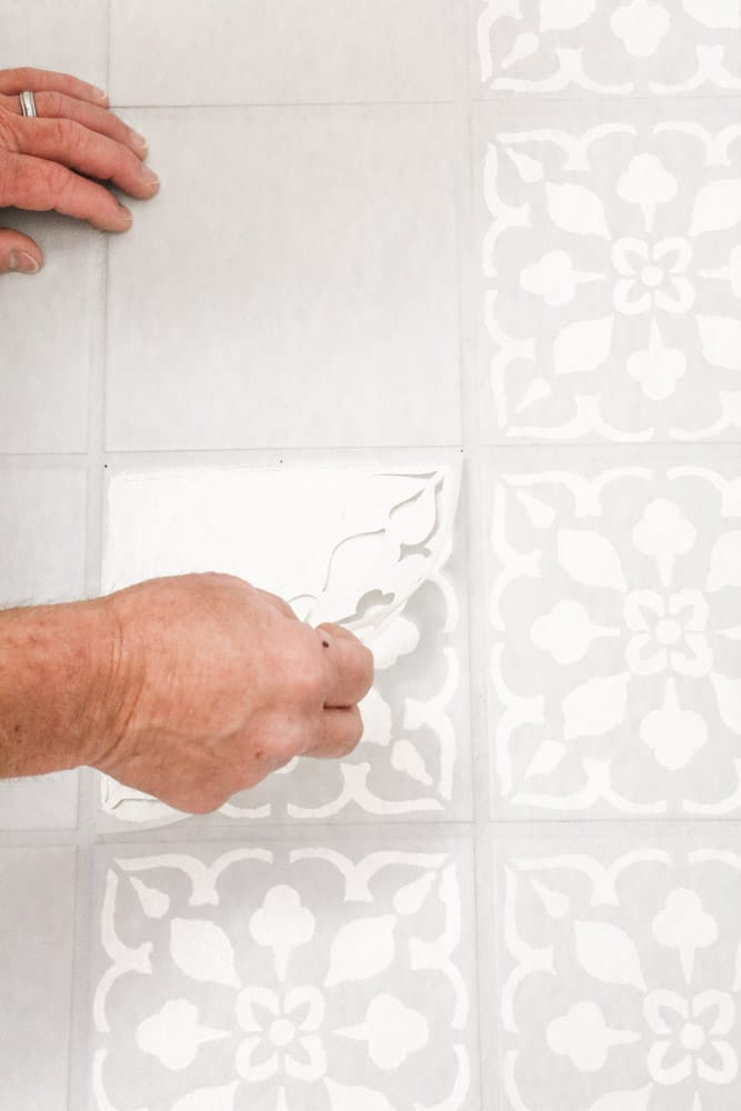 Remove the painted stencil from the tile floor