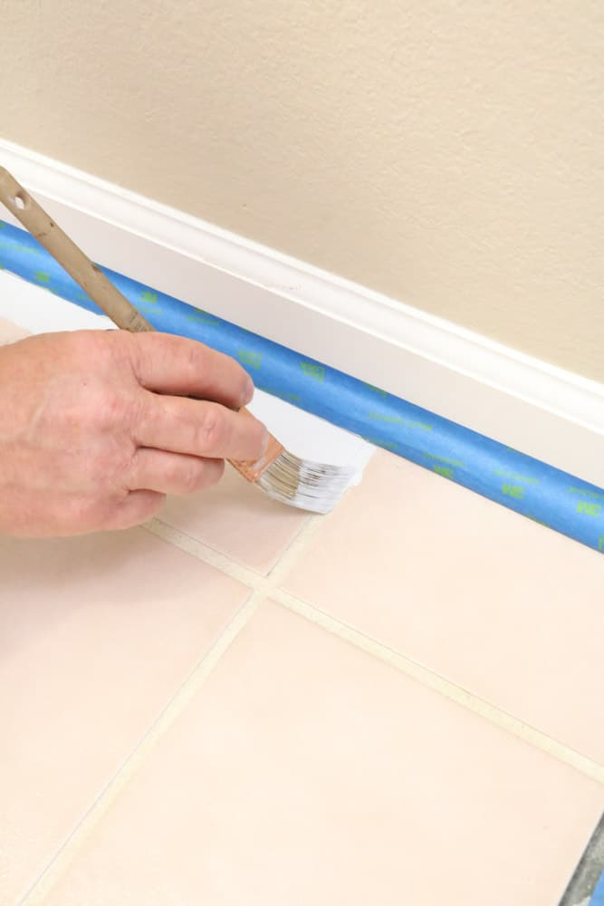 Paint along the edges first when painting ceramic tile floors