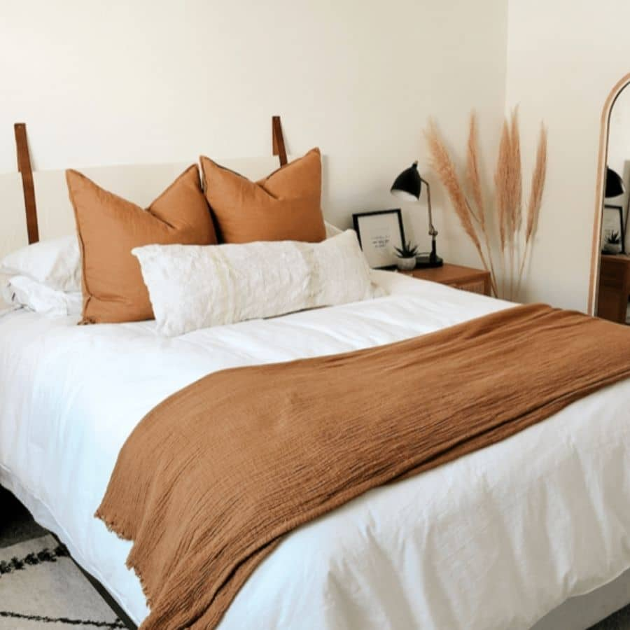 This DIY headboard utilizes leather straps to hand the headboard.