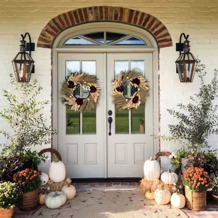 Autumn french door with loads of mums and monochromatic colored pumpkins.