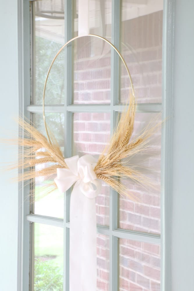 Front door wreath idea using wheat for autumn