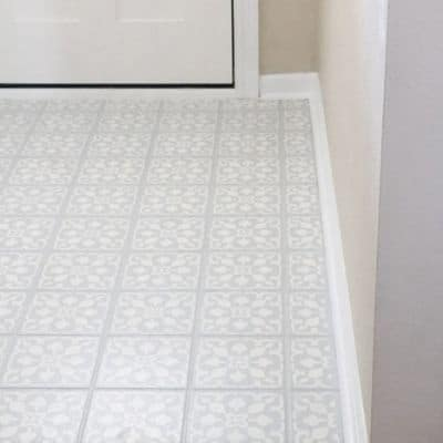 Paint over tile floors with stencil