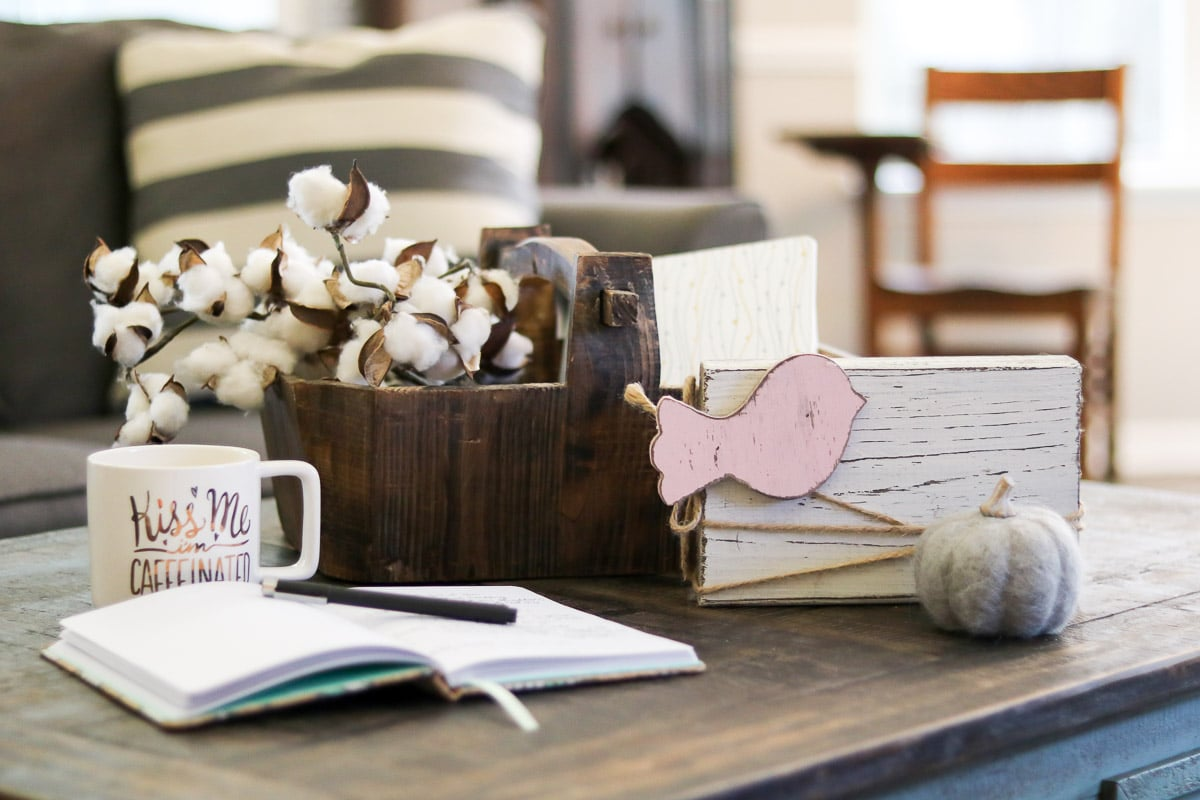 Farmhouse cotton accessories on a coffee table