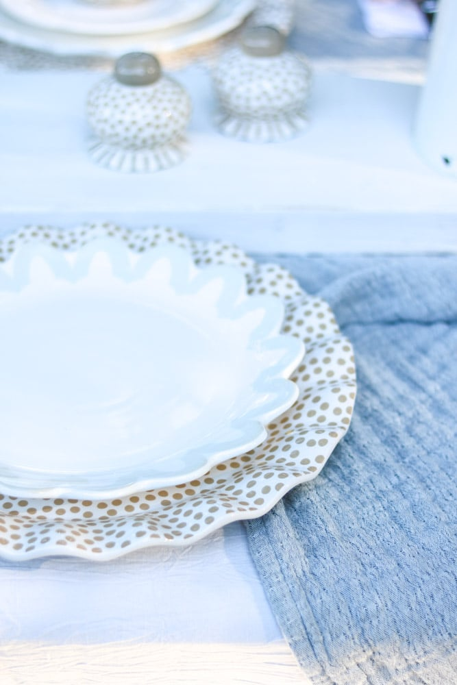Dinner plate by Coton Colors sitting on a ruffled polka dot platter
