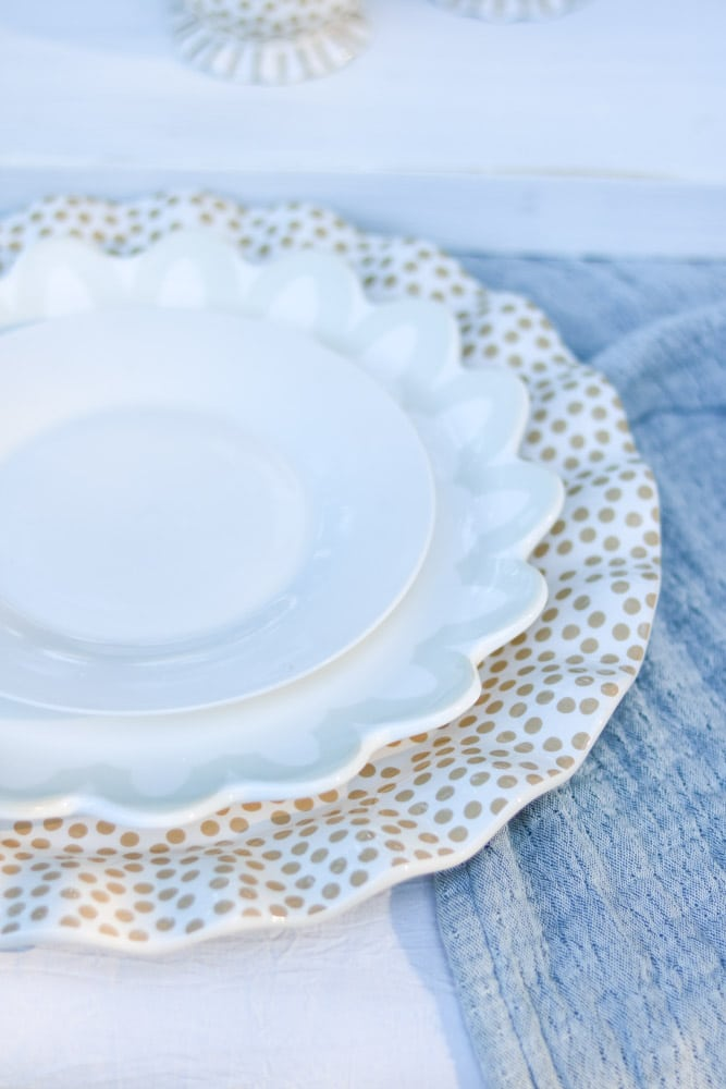 White salad plate sitting on a Coton Color dinner plate which is sitting on a ruffled polka dot platter for a fall tablescape.