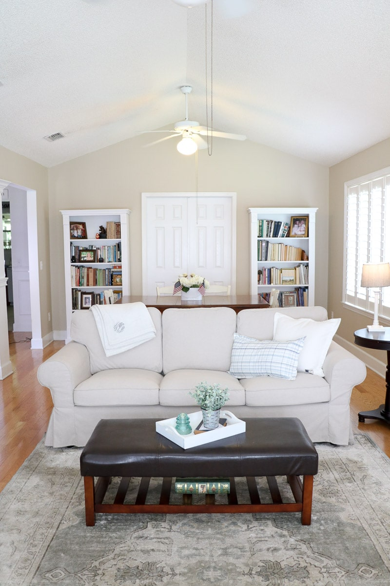 Farmhouse paint color of a living room painted Benjamin Moore Bone White