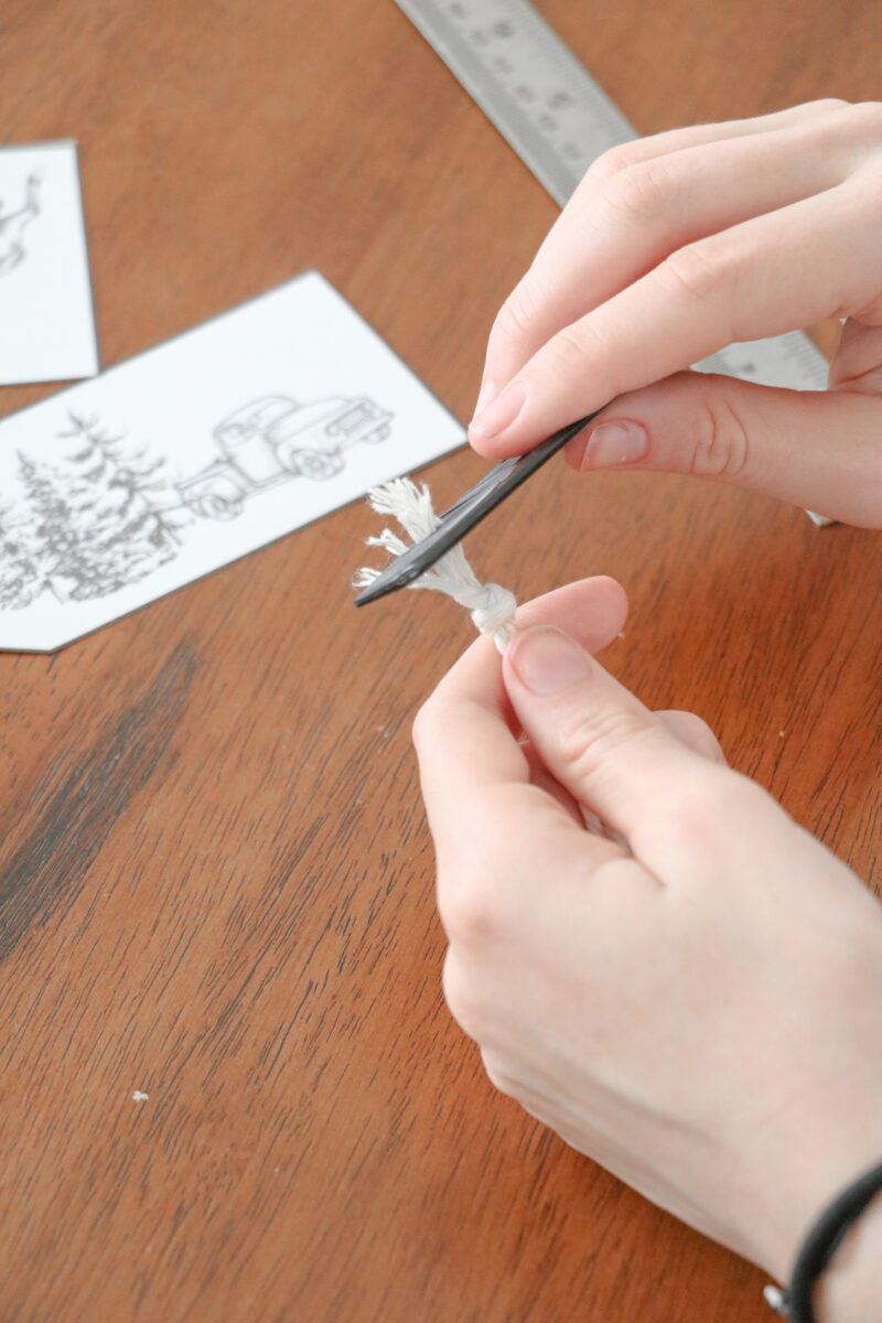 Combing twine on the end of a free printable gift tag for Christmas