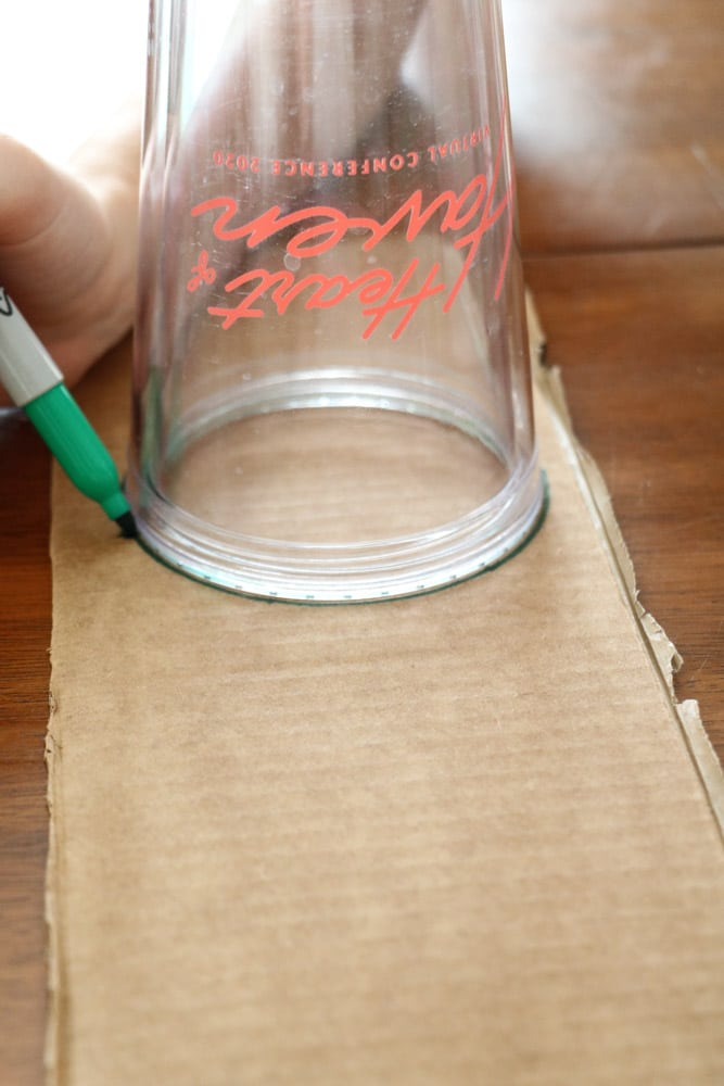 Draw a circle around a cup on a piece of cardboard