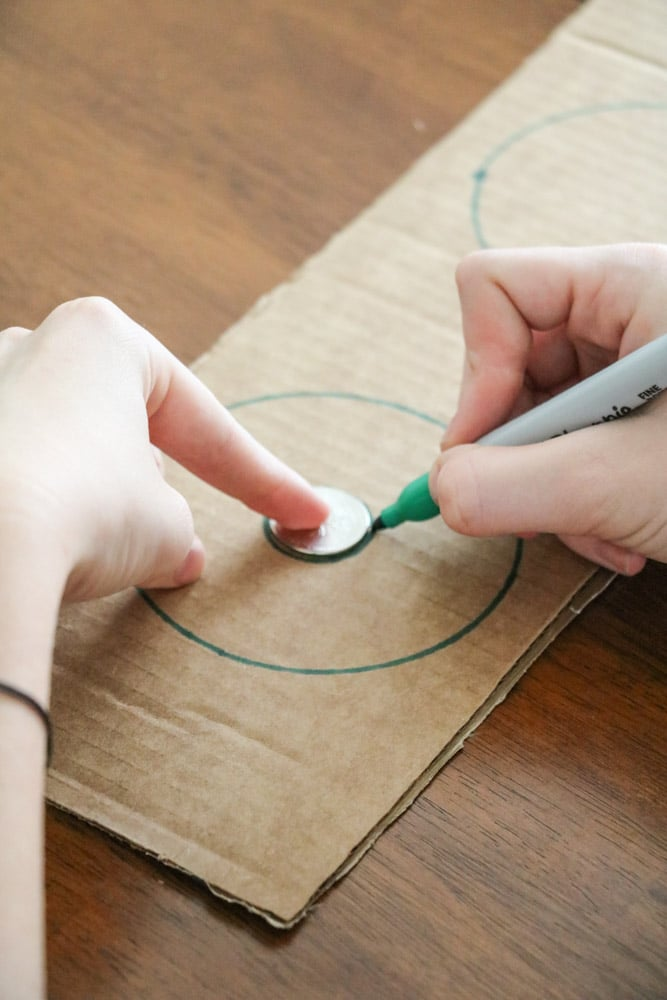 Draw around a quarter that is in the center of the big circle to make a pom pom