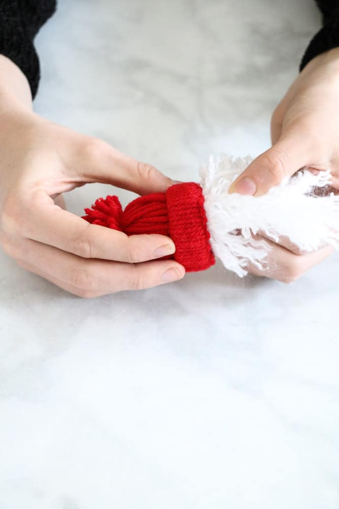 Attach beard to winter hat for yarn Santa garland