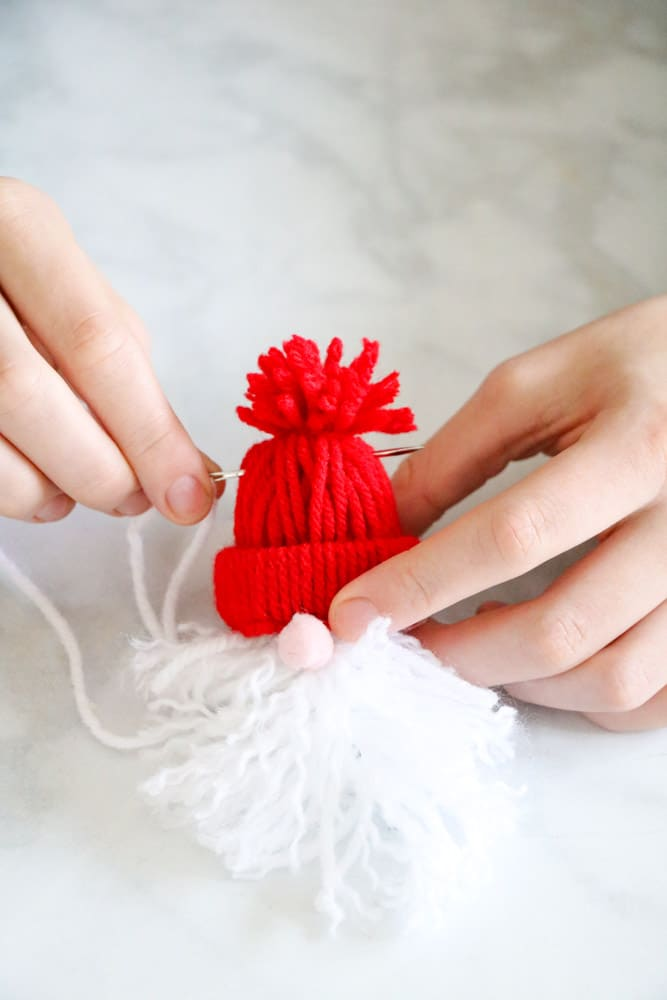 Sew through the top of the beanie to make a Christmas Santa garland