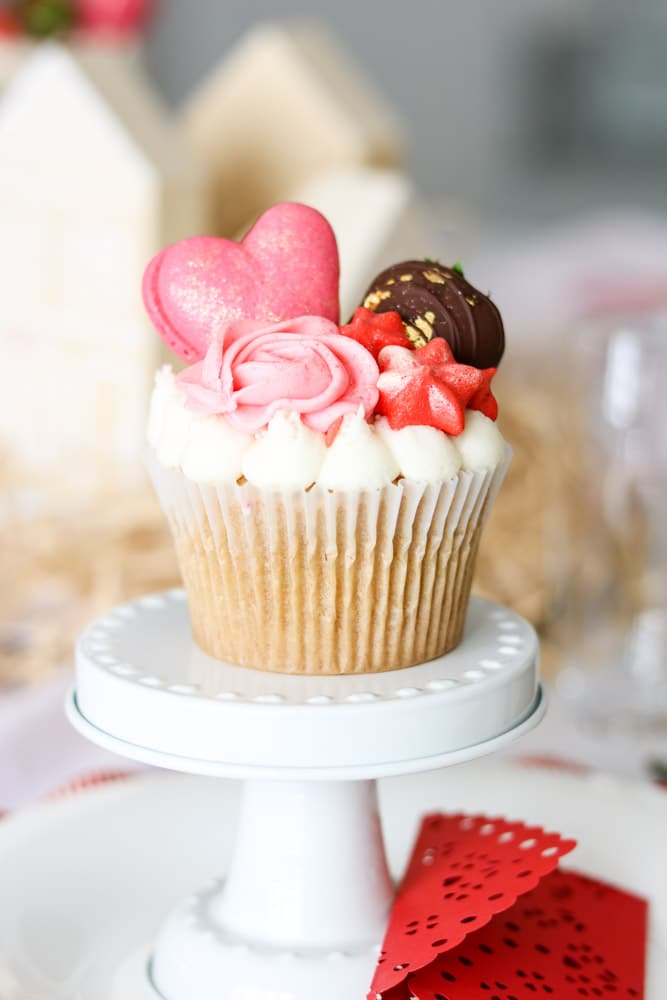 Valentine's day cupcake by Les Cherie place setting centerpiece on a family Valentine tablescape