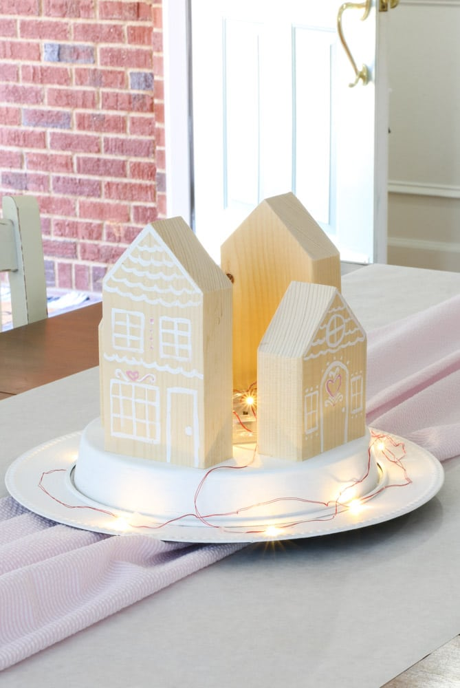 How to make a centerpiece for Valentine's day for the family using gingerbread houses