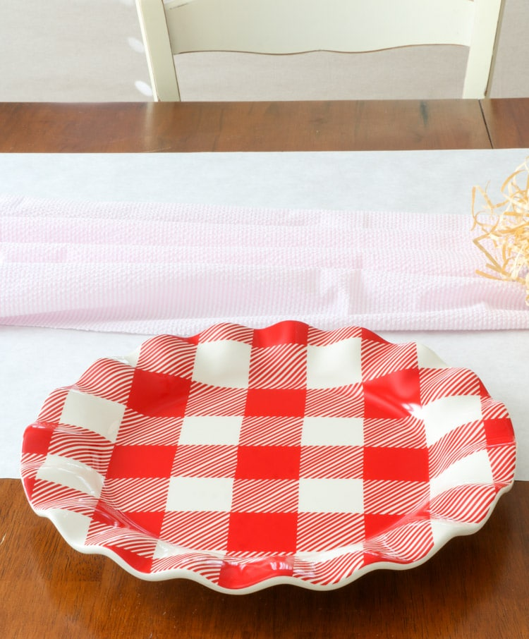 Valentine dinner place setting using buffalo check red and white ruffle plates by Coton Colors