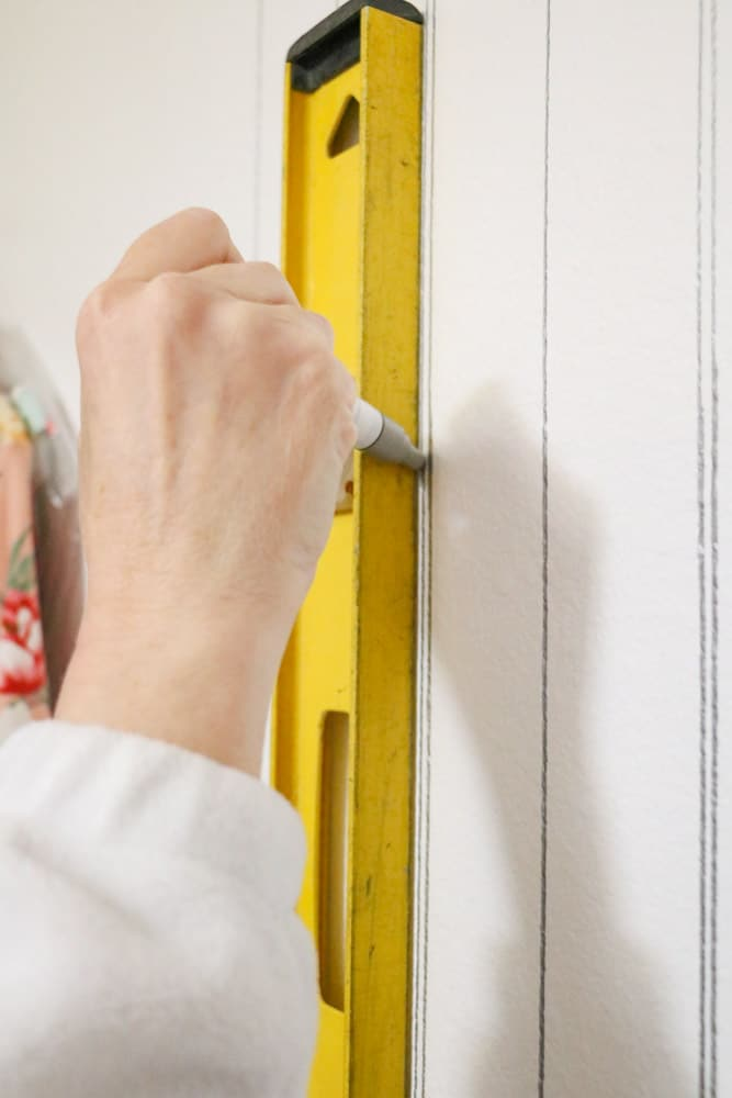 Use a paint pen to draw a fake beadboard