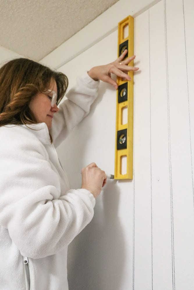 Draw a beadboard pattern on a wall with a marker