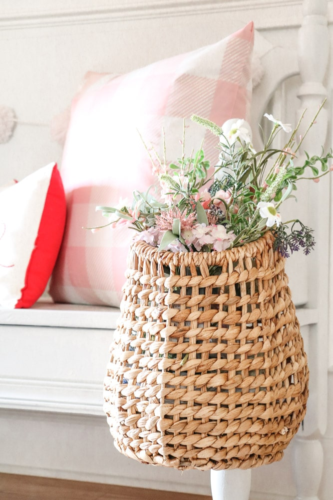 Basket of flowers as decorations on a Valentine's entryway