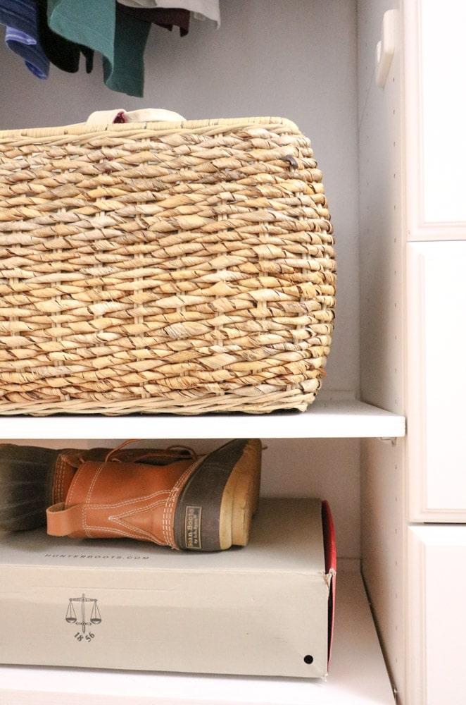 Basket storage on shelf in organized closet