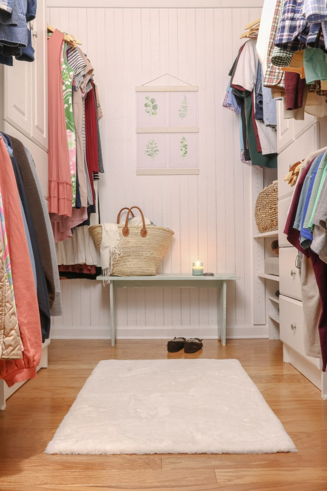 Organize clothes by color in small walk in closet