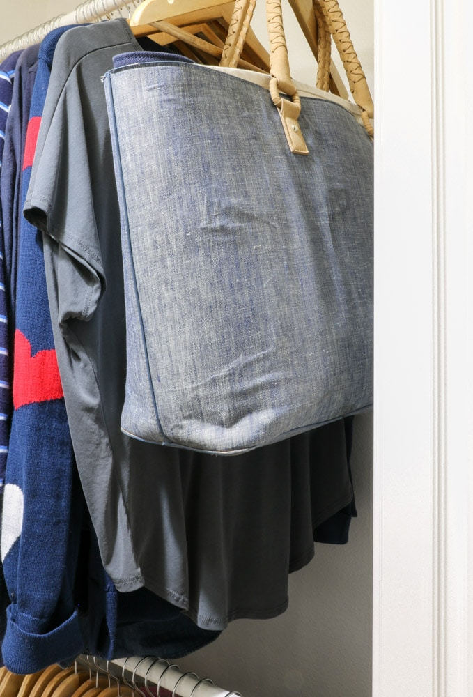 Store purses in a large tote and hang it in your closet