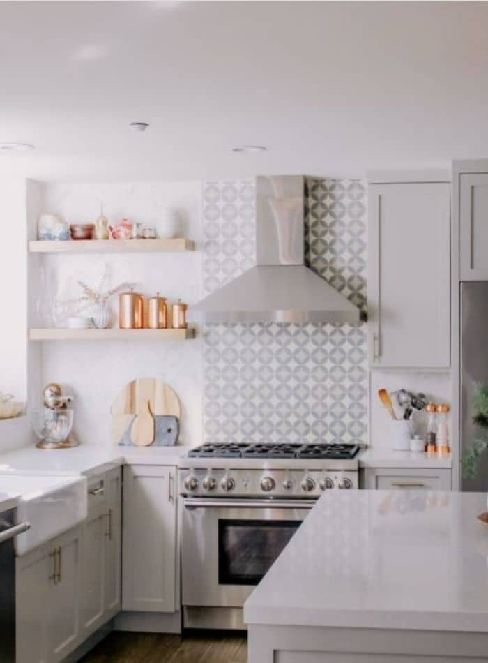 Popular Sherwin Williams Grey cabinet color that match a diamond patterned backsplash with light wooden shelves