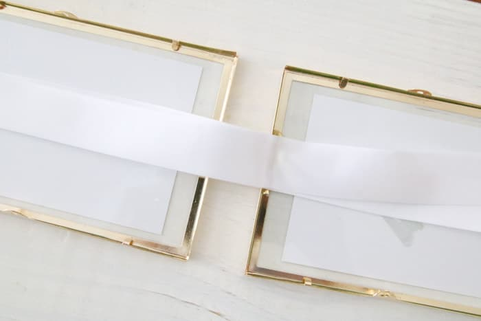Gluing ribbon to frames for a printable wall hanging of birth month flowers for Mother's day.