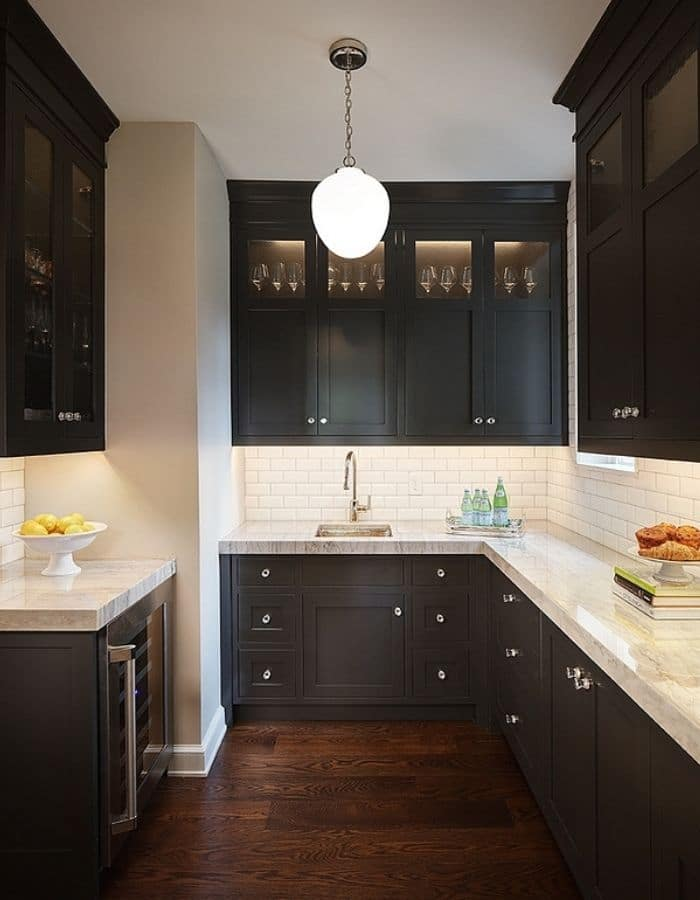 Popular Sherwin Williams black paint color for cabinets.  Iron Ore high glass cabinets.