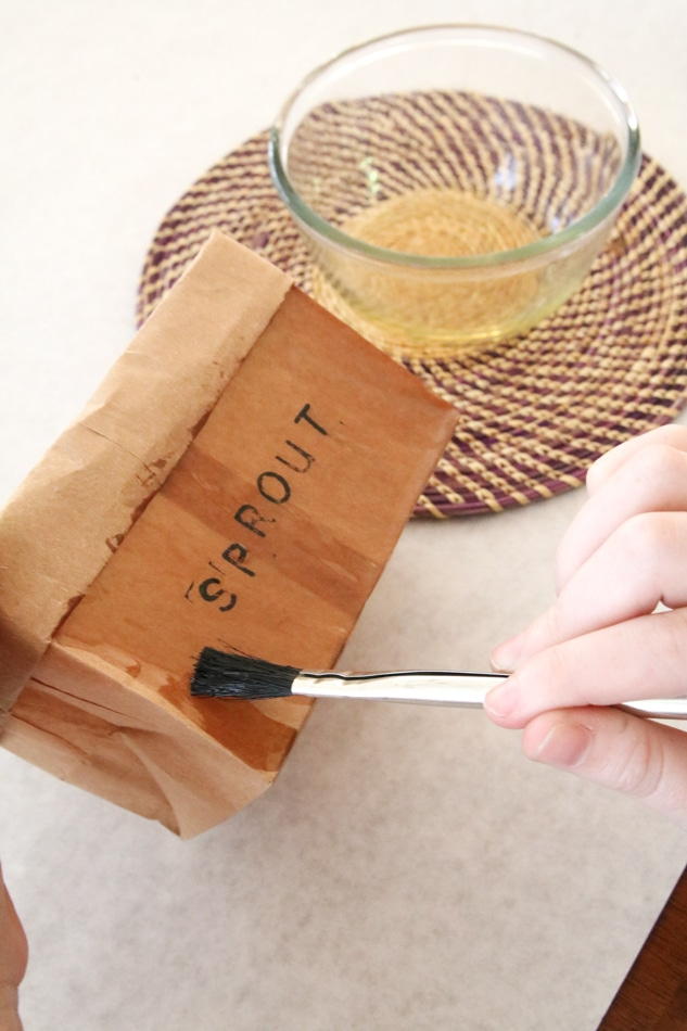 Apply wax to brown paper bag planter to make it water resistant
