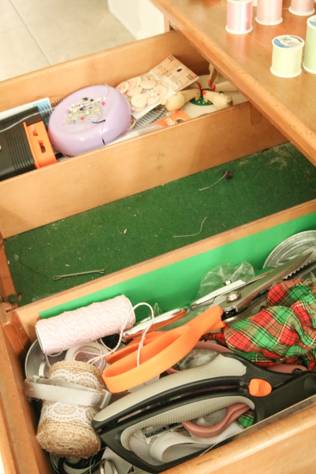 How to organize sewing supplies by cleaning out the drawer first.