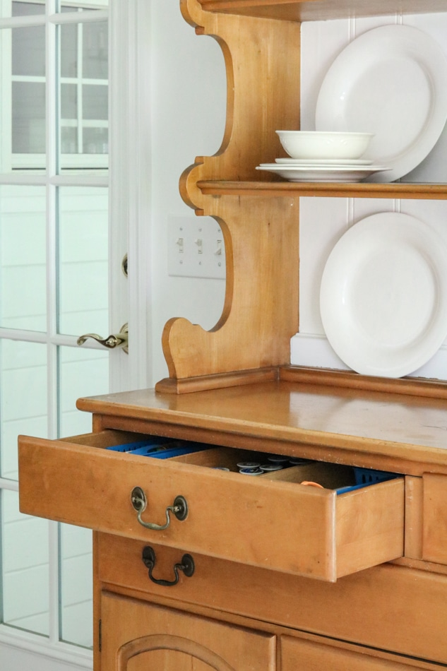Storing sewing supplies in a hutch