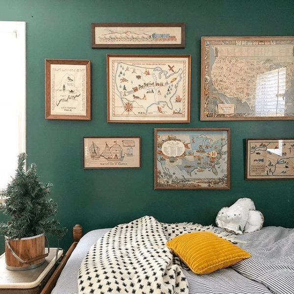Trendy and popular Sherwin Williams dark green paint color Isle of Pines in a bedroom.