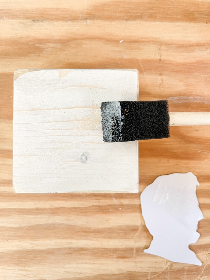 Brush decoupage on a painted wood block for silhouette
