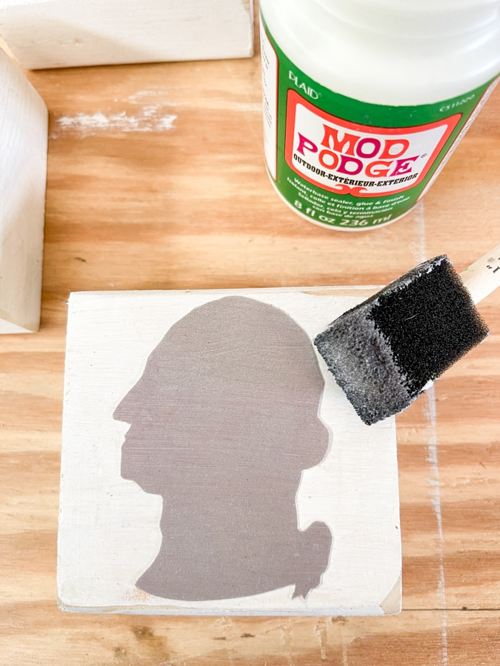 Adding decoupage to the top of a president silhouette patriotic decoration