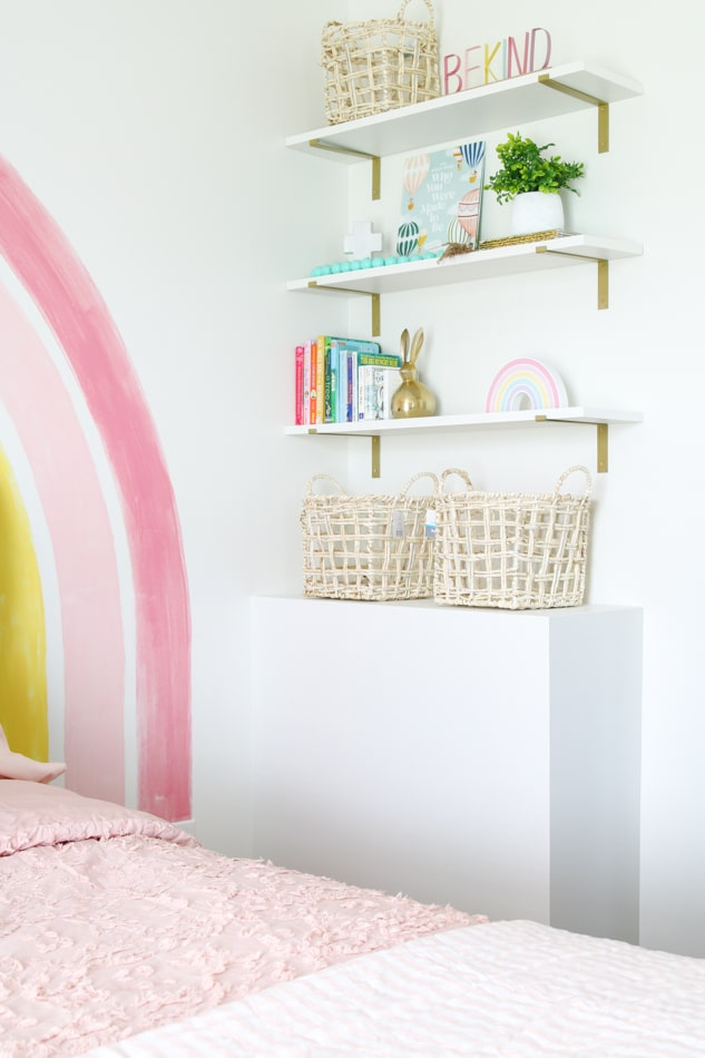 Bookcase in a rainbow bedroom