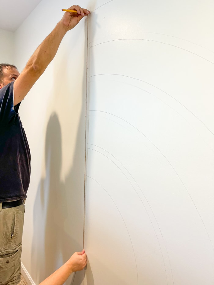 Drawing a rainbow on a wall