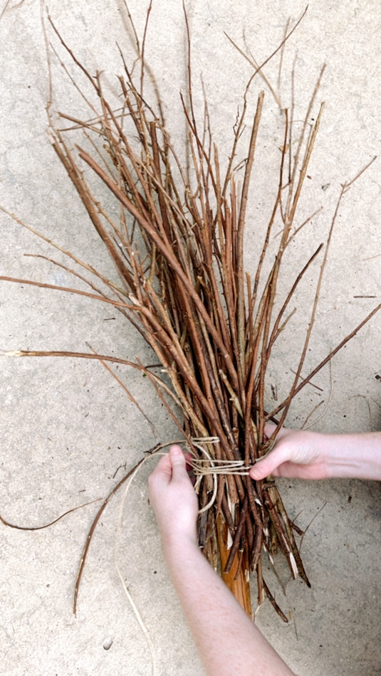 Making a witch broom from twigs and twine