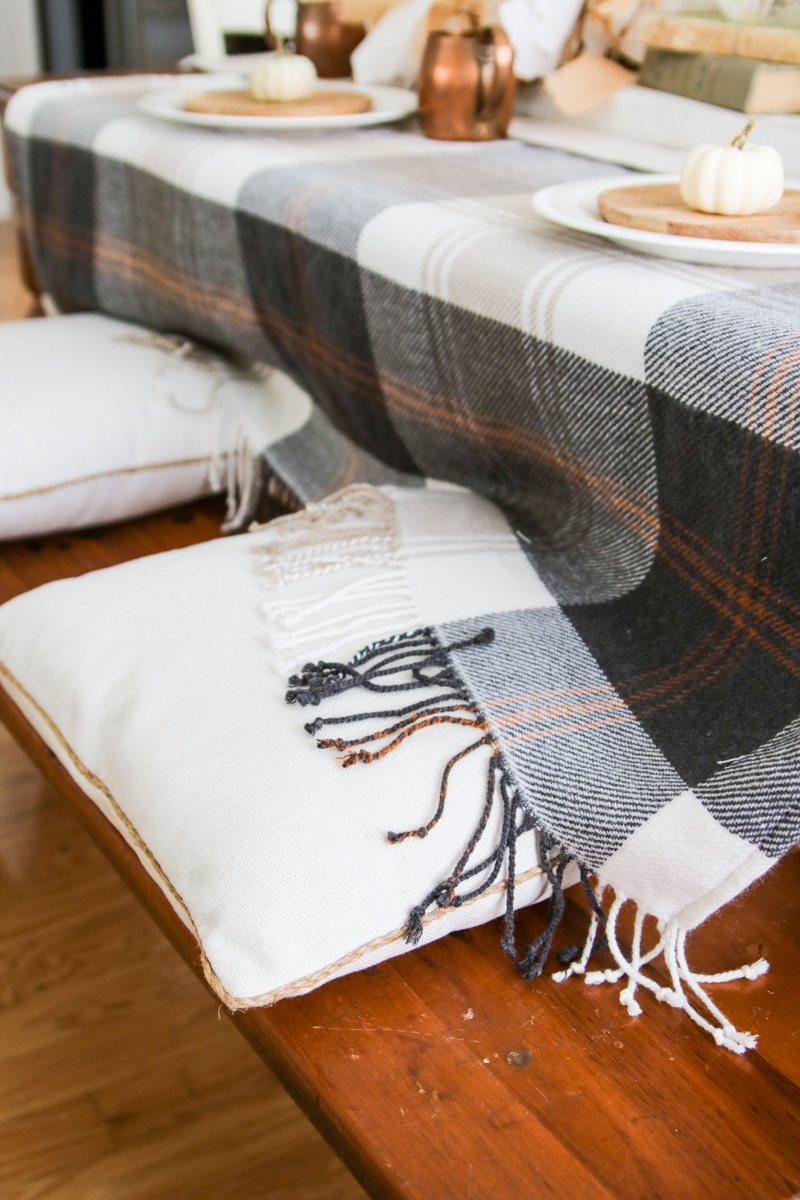PIllows on a bench for a tablescape
