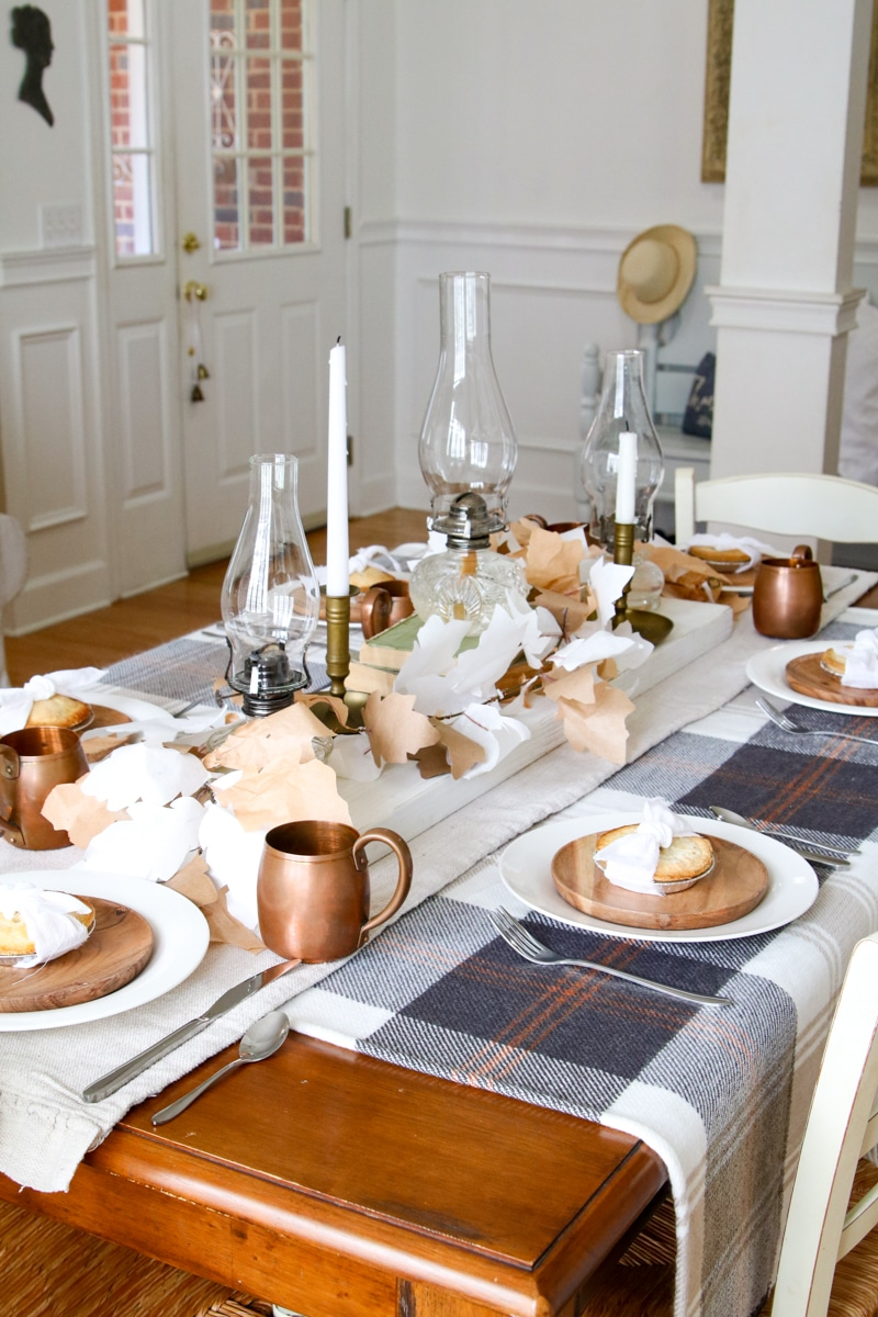 simple Thanksgiving table with plaid, chamber lamps and mini pies